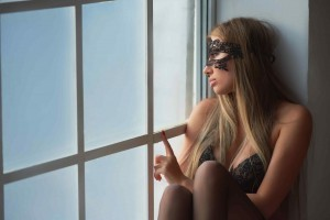 Girl sad looking out window